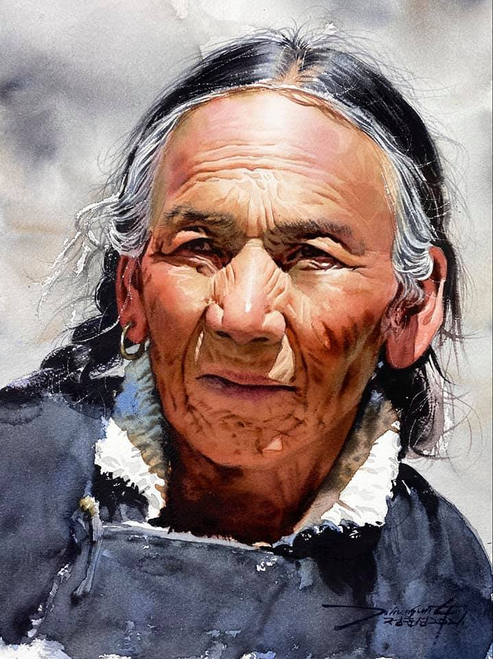 A portrait of a Native American looking person.